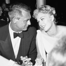 "Cary Grant shares a moment with Kim Novak at the screening of her film, ""Middle of the Night"", Cannes, 1959."