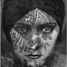 Edward Steichen (1879 – 1973) Gloria Swanson. Image appeared in Vanity Fair's 1928 issue and features a dramatically made up Gloria Swanson in a black headwrap behind a screen of lace..
