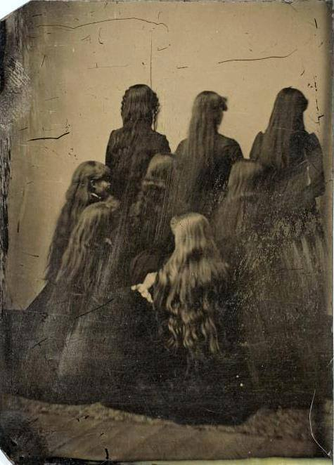 Tintype portrait of eight women displaying their hair, U.S.A., ca. 1880. Possibly the Sutherland Sisters