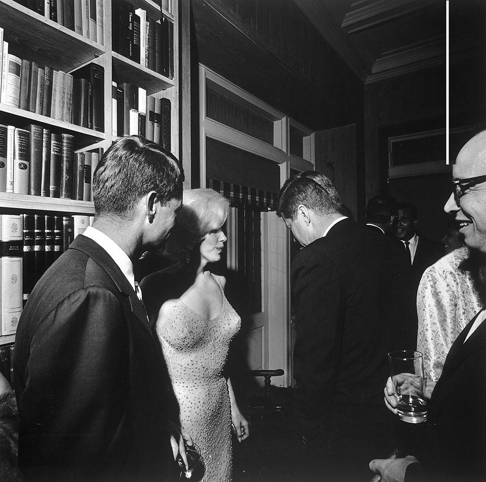 "The only known photograph of Marilyn Monroe and John F. Kennedy together. During a party at the home of movie executive Arthur Krim, Marilyn stands between Robert Kennedy (left) and John F. Kennedy. The party followed a democratic fundraiser at Madison Square Garden honoring John F. Kennedy's birthday where Monroe famously sang ""Happy Birthday"". Date: 19 May 1962"