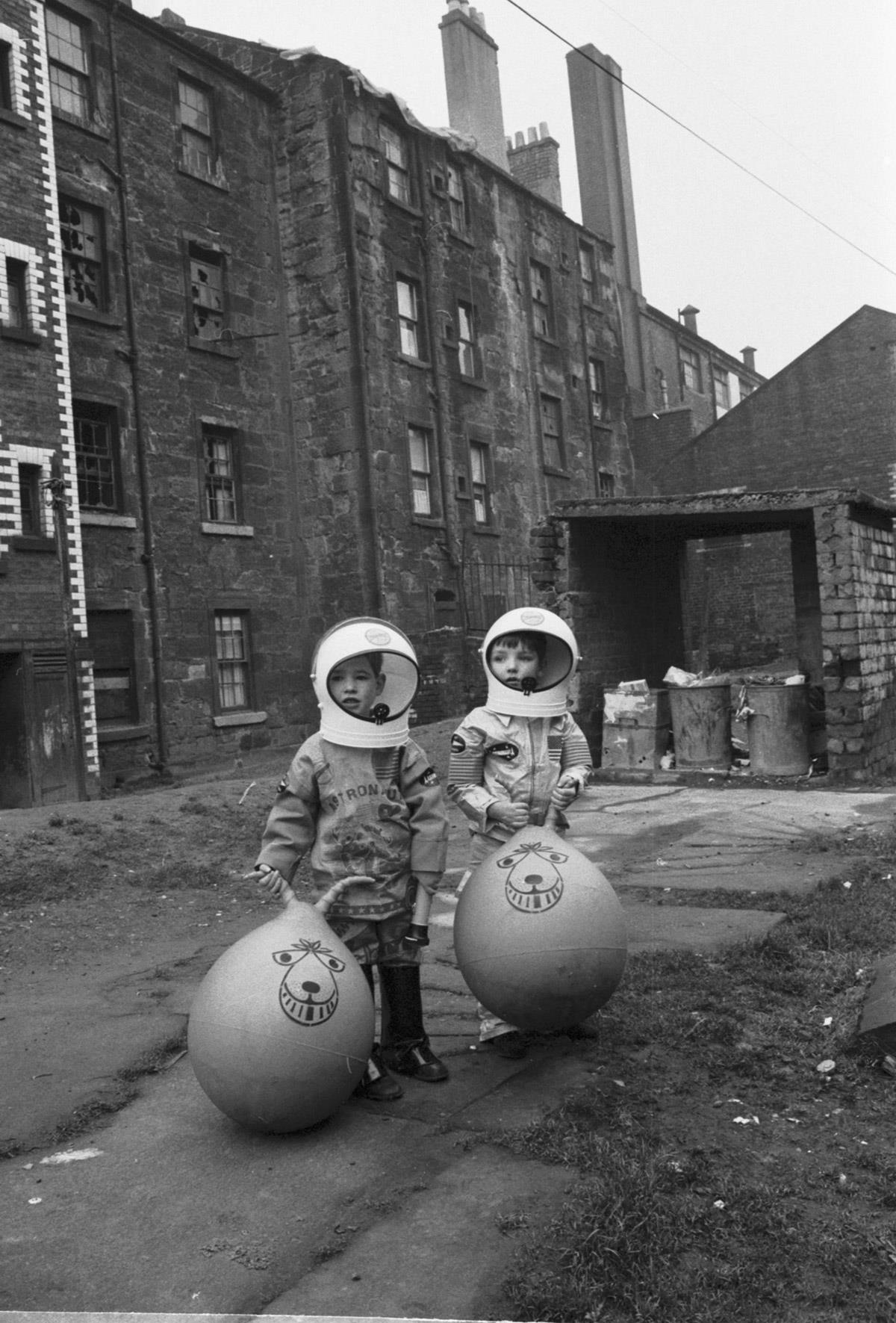 Boys with astronaut costumes and spacehoppers, Glasgow, Christmas 1970