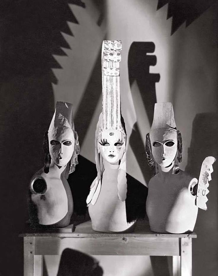 George Hoyningen-Huené: Three masks designed by Oliver Messel, worn by Lady Mendl (Elsie de Wolfe) and her two escorts to the Flora and Fauna ball given by Comte de Beaumont. Vogue, December 8, 1928